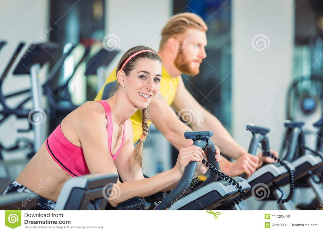 Portrait of a beautiful woman during cardio routine on stationary bicycle