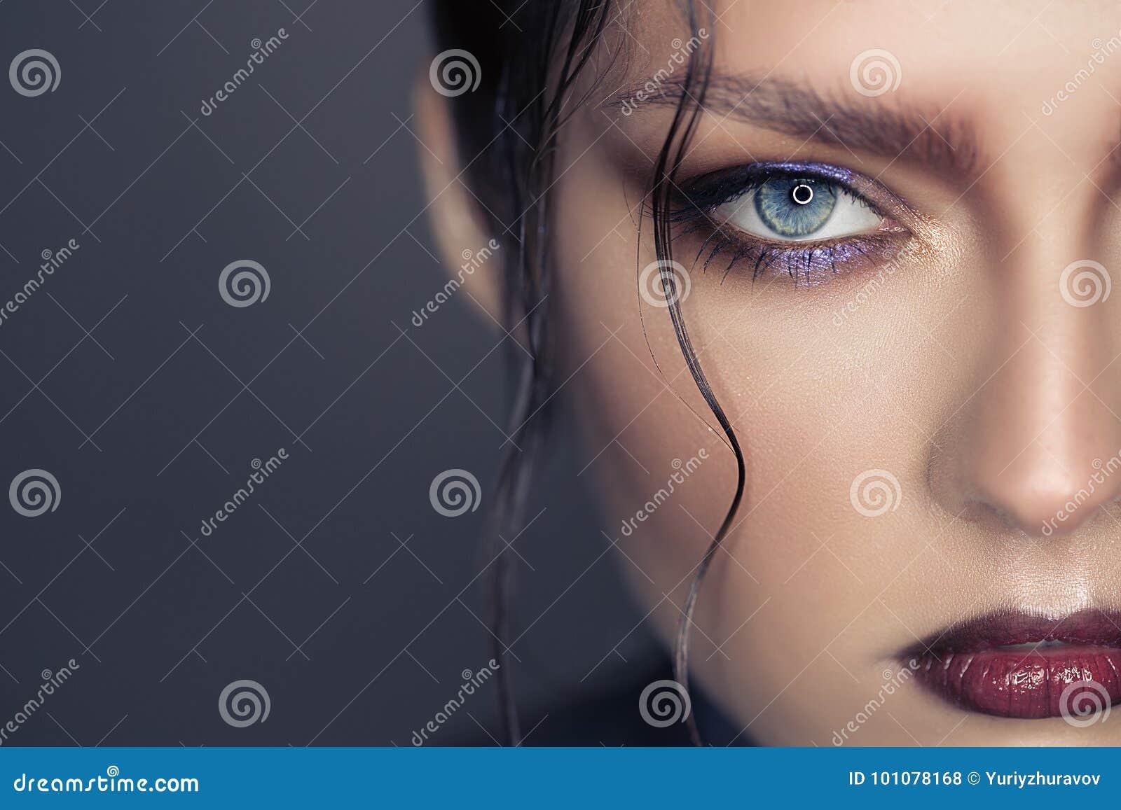 Portrait of beautiful woman. Fantasy make-up.