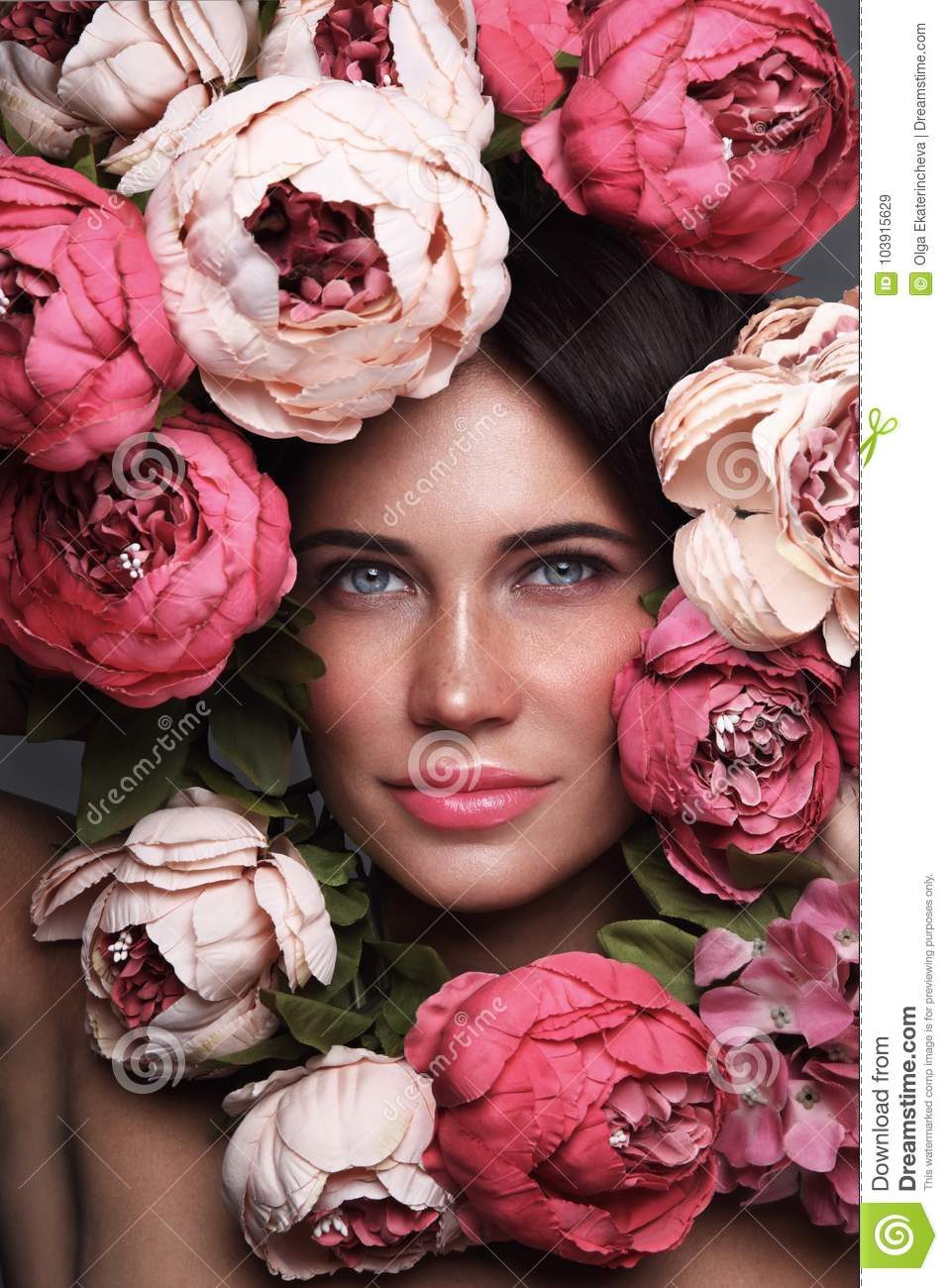 Portrait of beautiful woman with flowers around her face stock image portrait of beautiful woman with flowers around her face izmirmasajfo