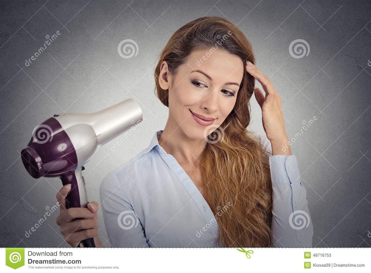 Portrait beautiful woman with a hairdryer
