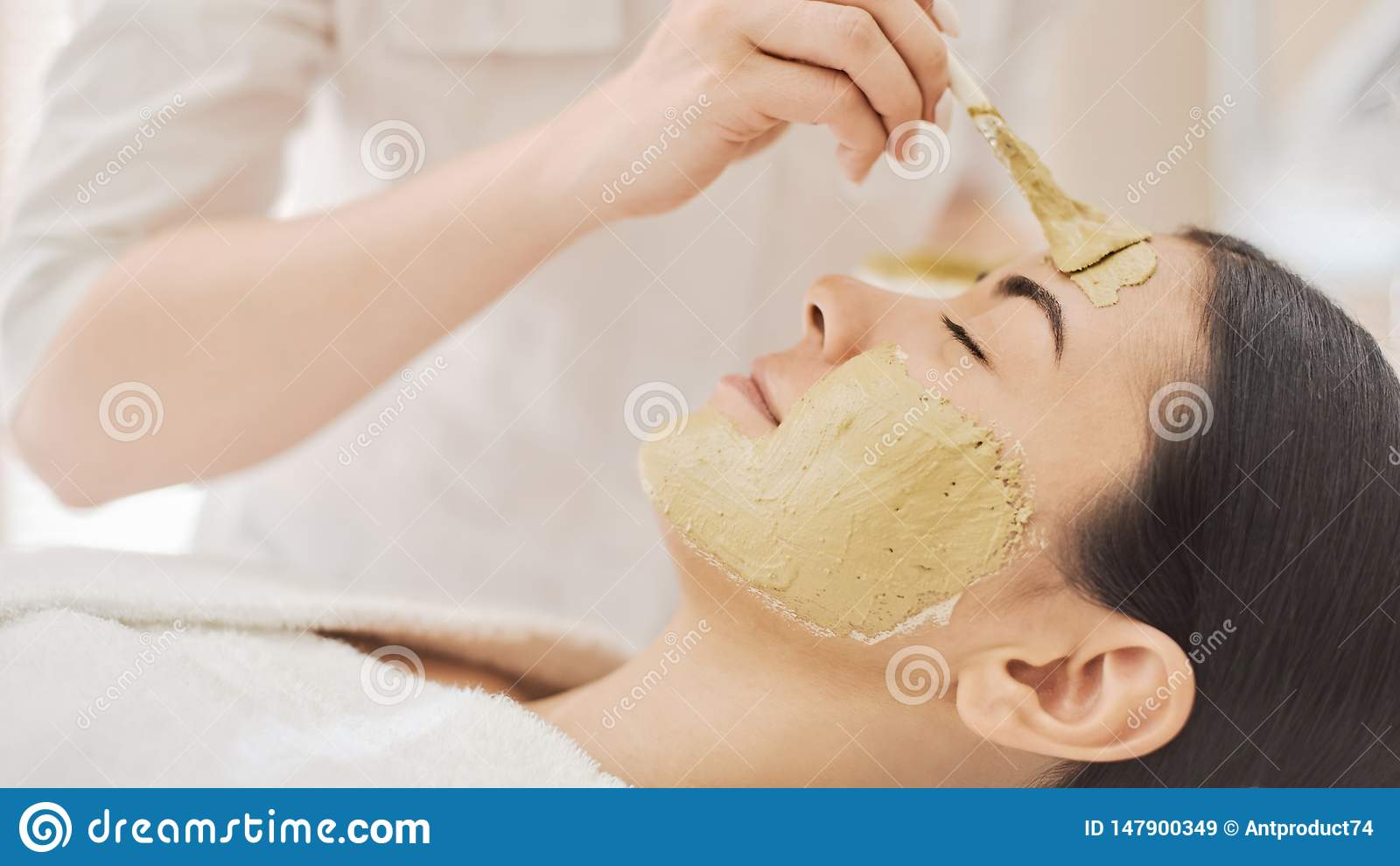 Woman getting mask in spa