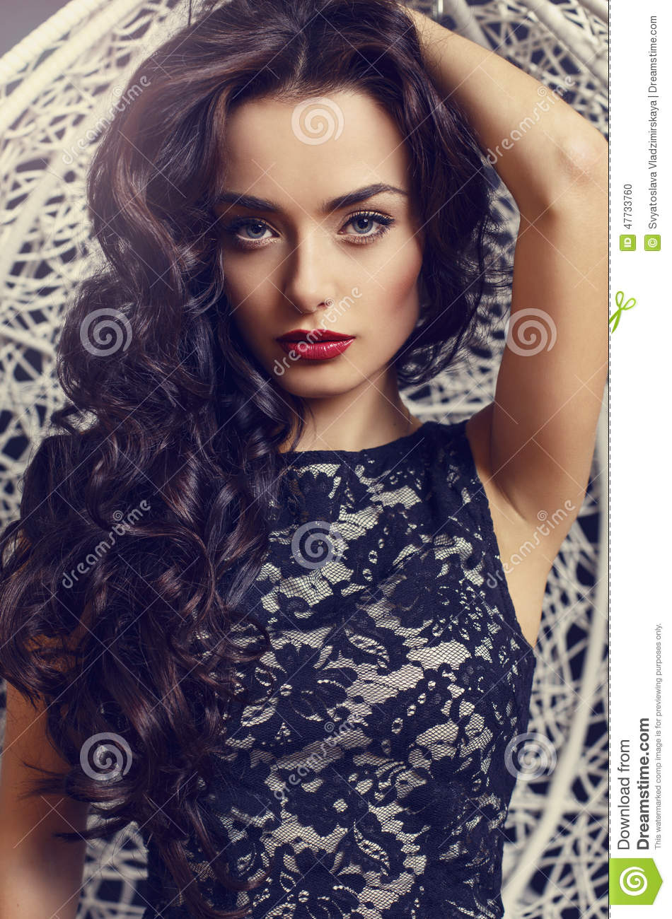 66f51bfc8fbe7 Fashion studio portrait of beautiful sensual woman with long dark curly hair  wearing elegant lace dress