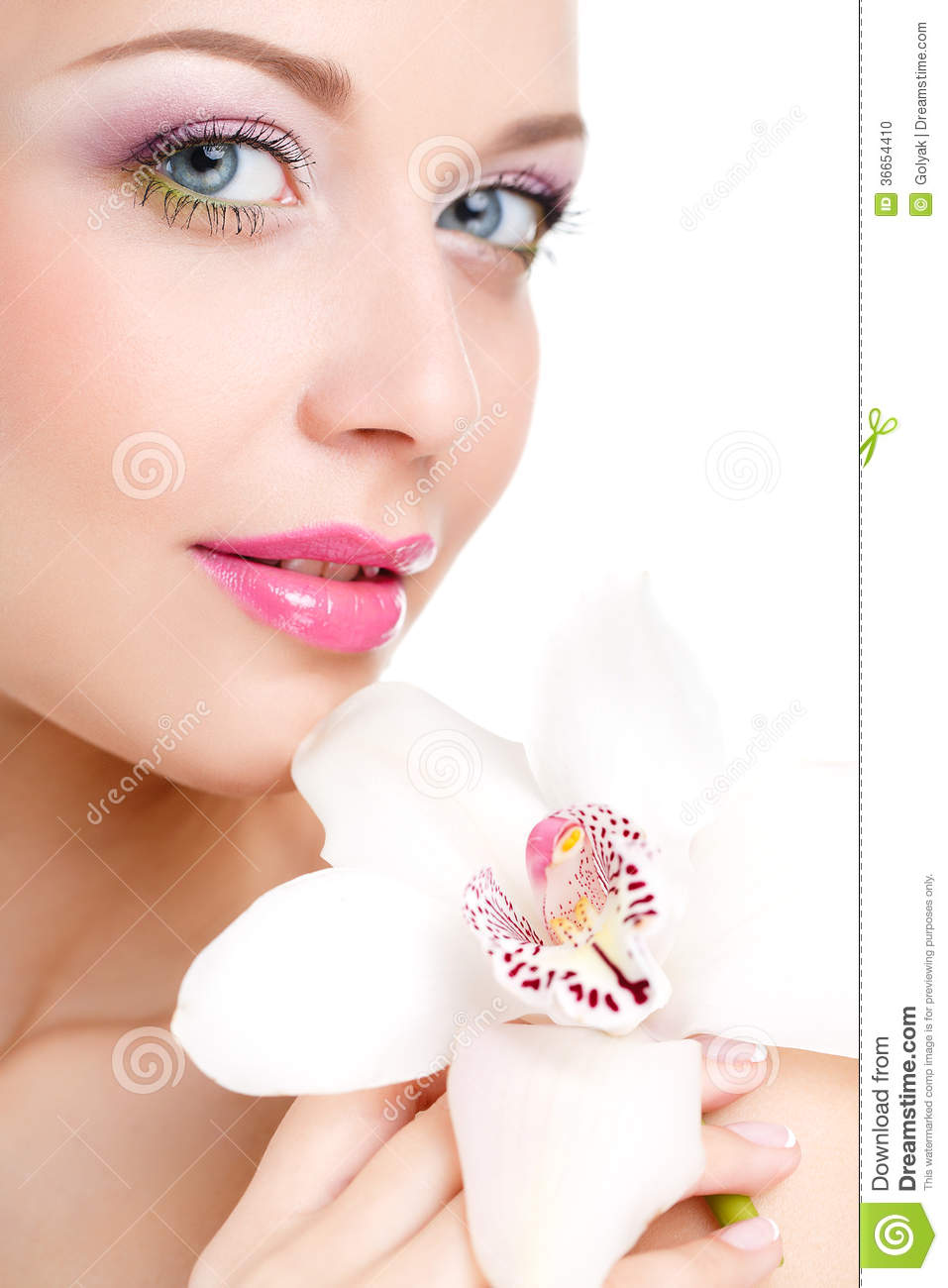 Portrait of beautiful woman with orchid flower in her hair for What make a beautiful