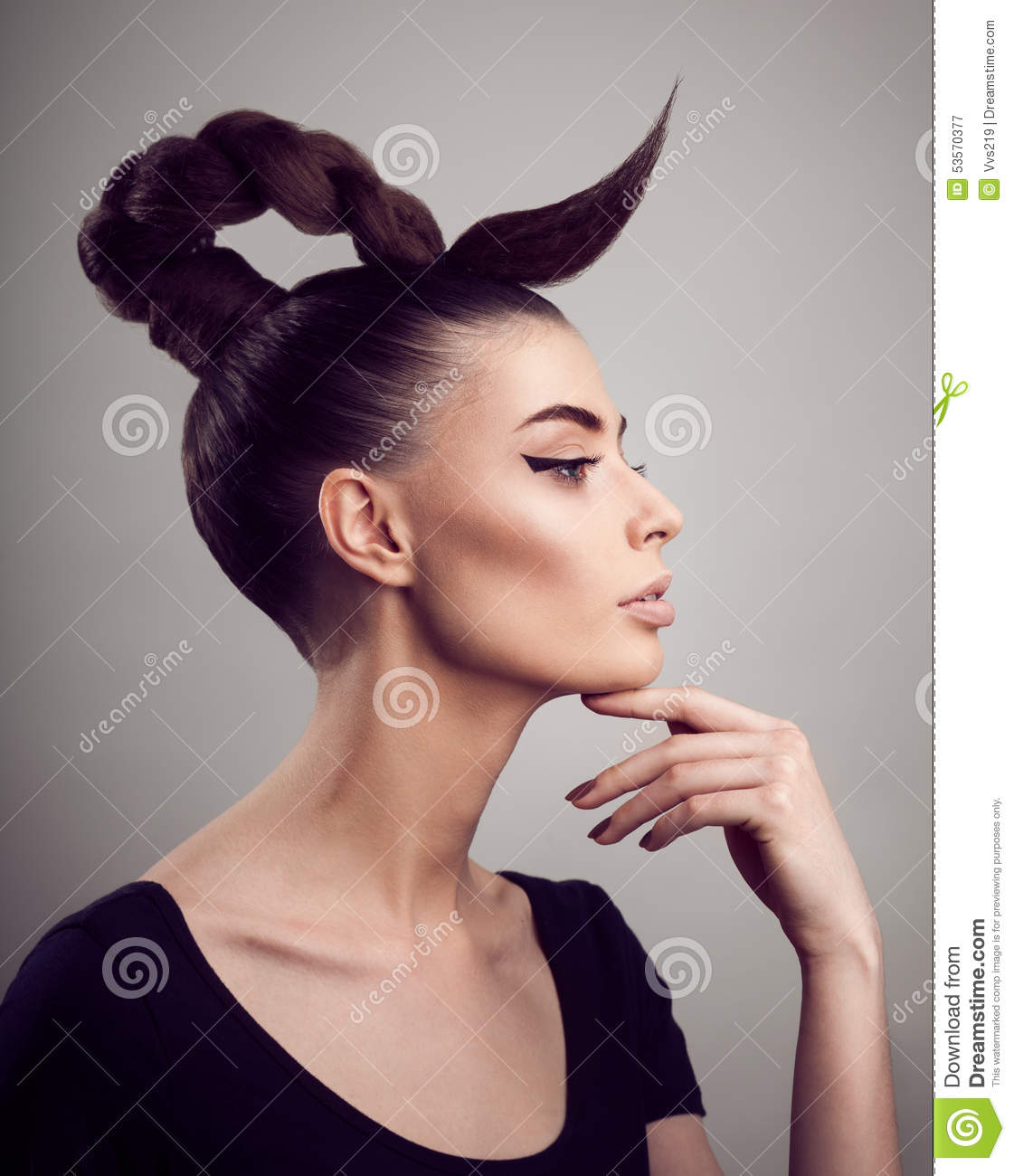 Portrait of beautiful woman with perfect skin and make-up. Creative hairstyle.