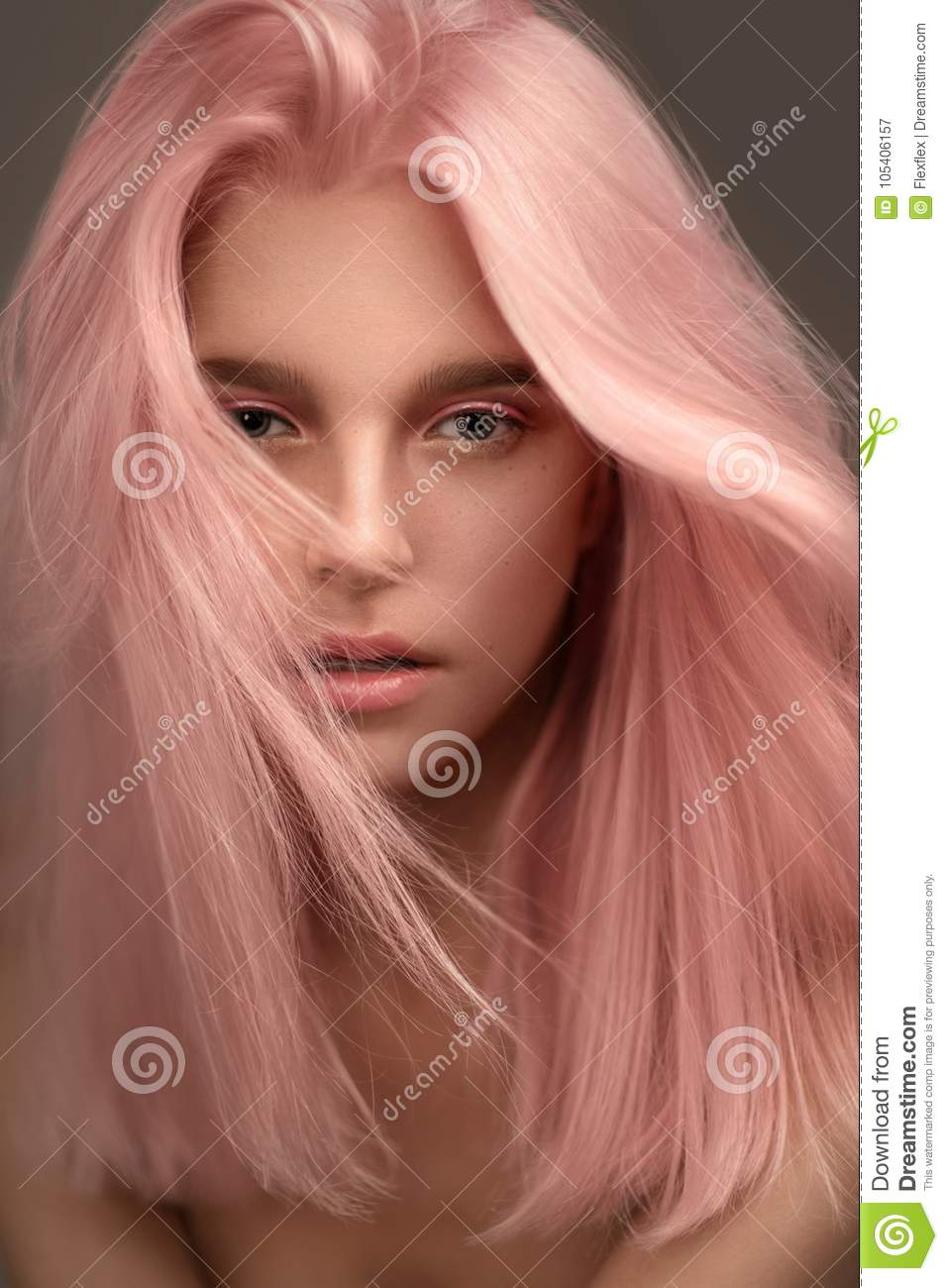 Portrait of beautiful woman with pink hair