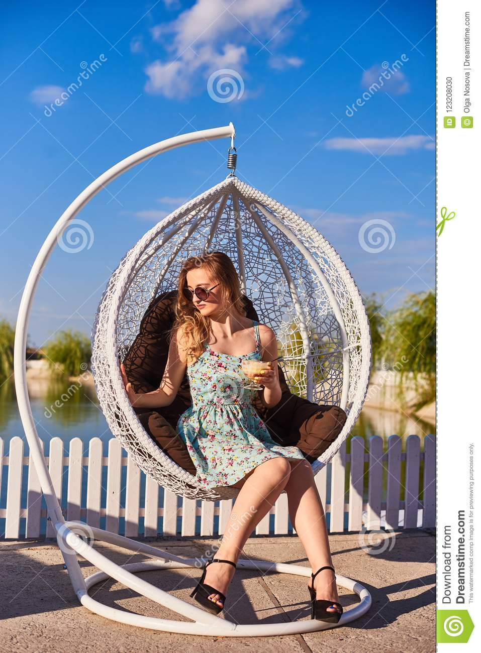 Admirable Portrait Of Beautiful Woman In Sitting In A White Hanging Machost Co Dining Chair Design Ideas Machostcouk