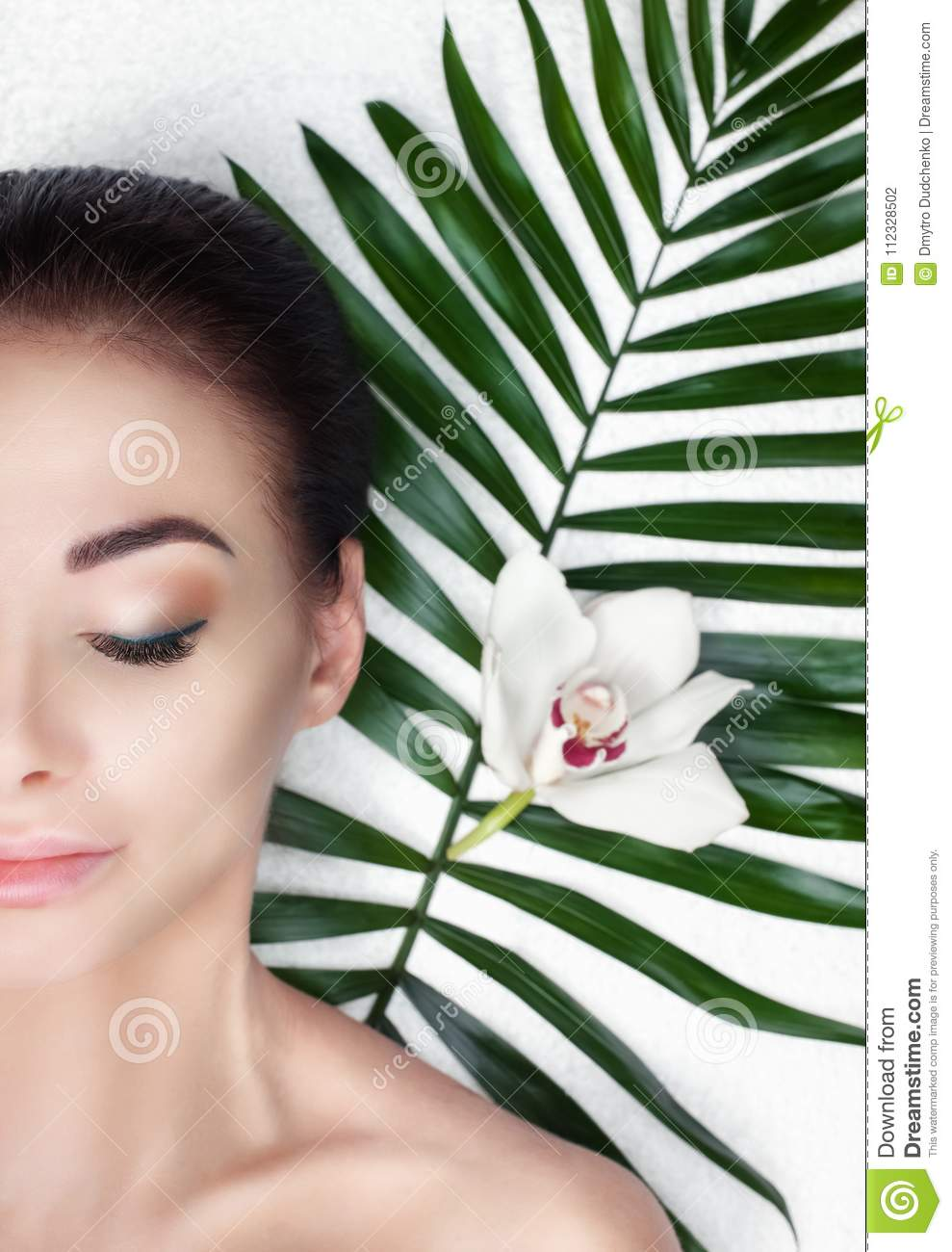 Portrait of a beautiful woman in a spa salon in front of a beauty treatment.