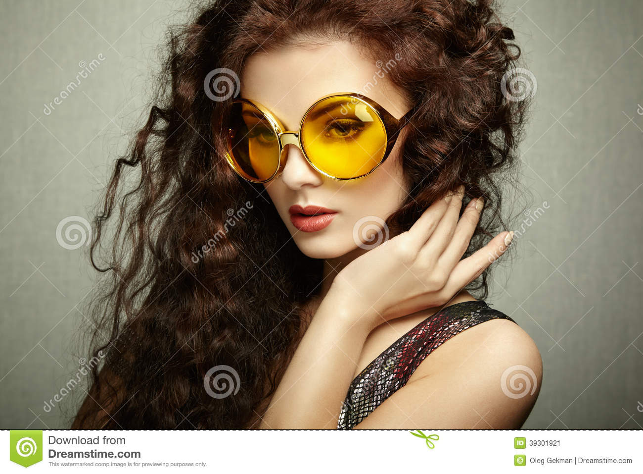 Portrait Of Beautiful Woman In Sunglasses On White