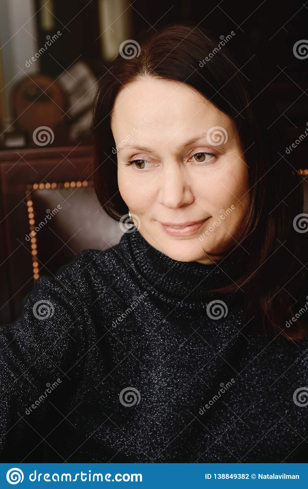 Portrait of a beautiful woman of 40 years
