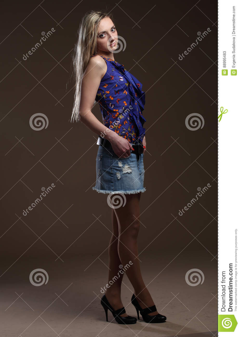 Portrait of a beautiful young adult slim and attractive sensuality pretty blonde woman in blue elegance fashionable shorts an