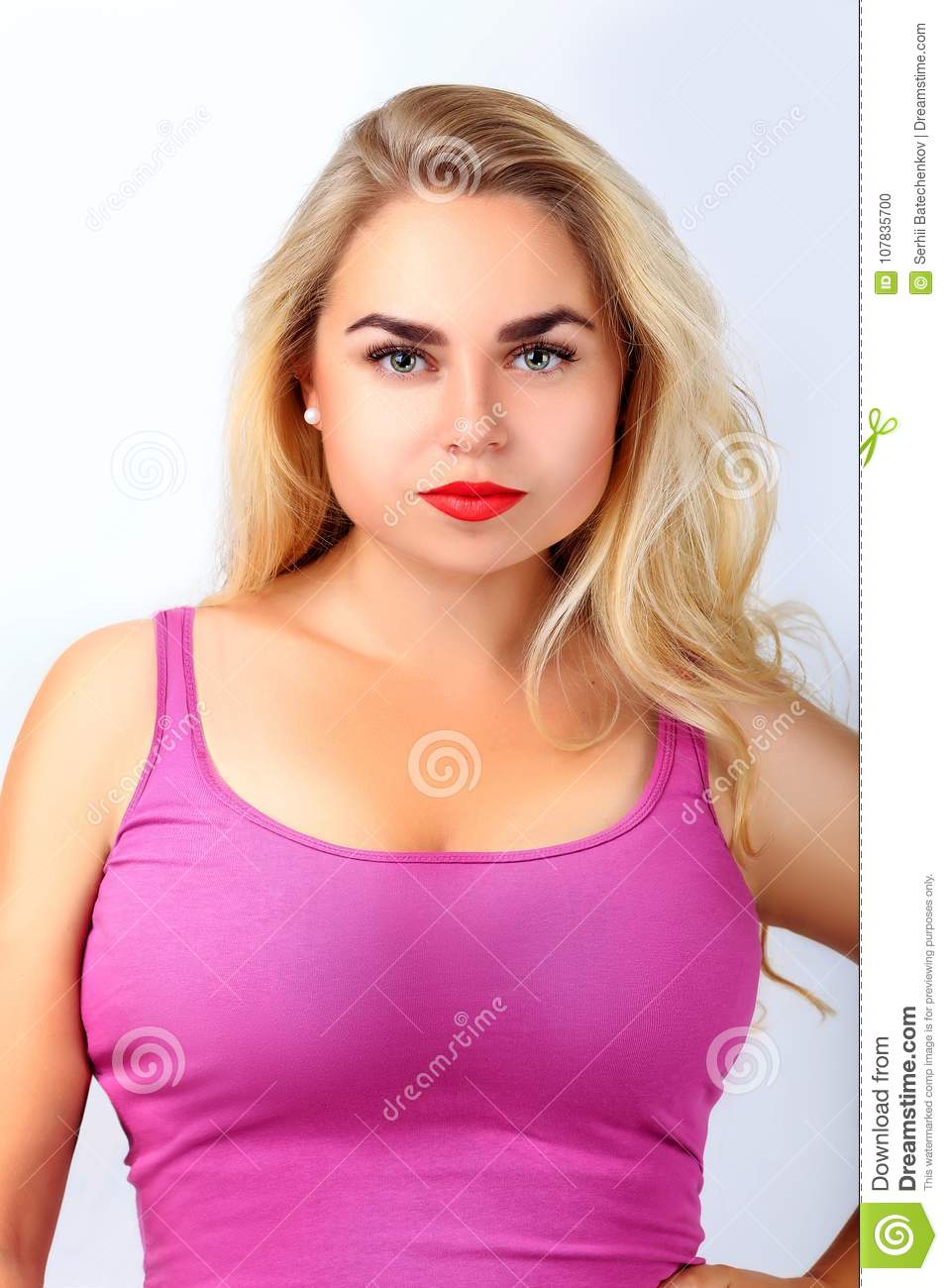 Portrait Of A Beautiful Young Blonde Girl With Perfect Skin And Big Breasts