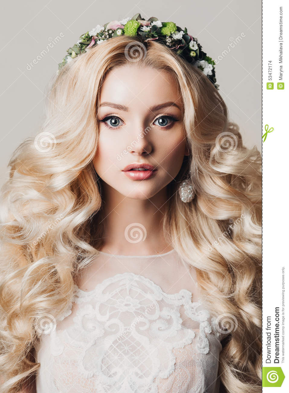 Portrait of a beautiful young blonde woman with long curly hair and eyes