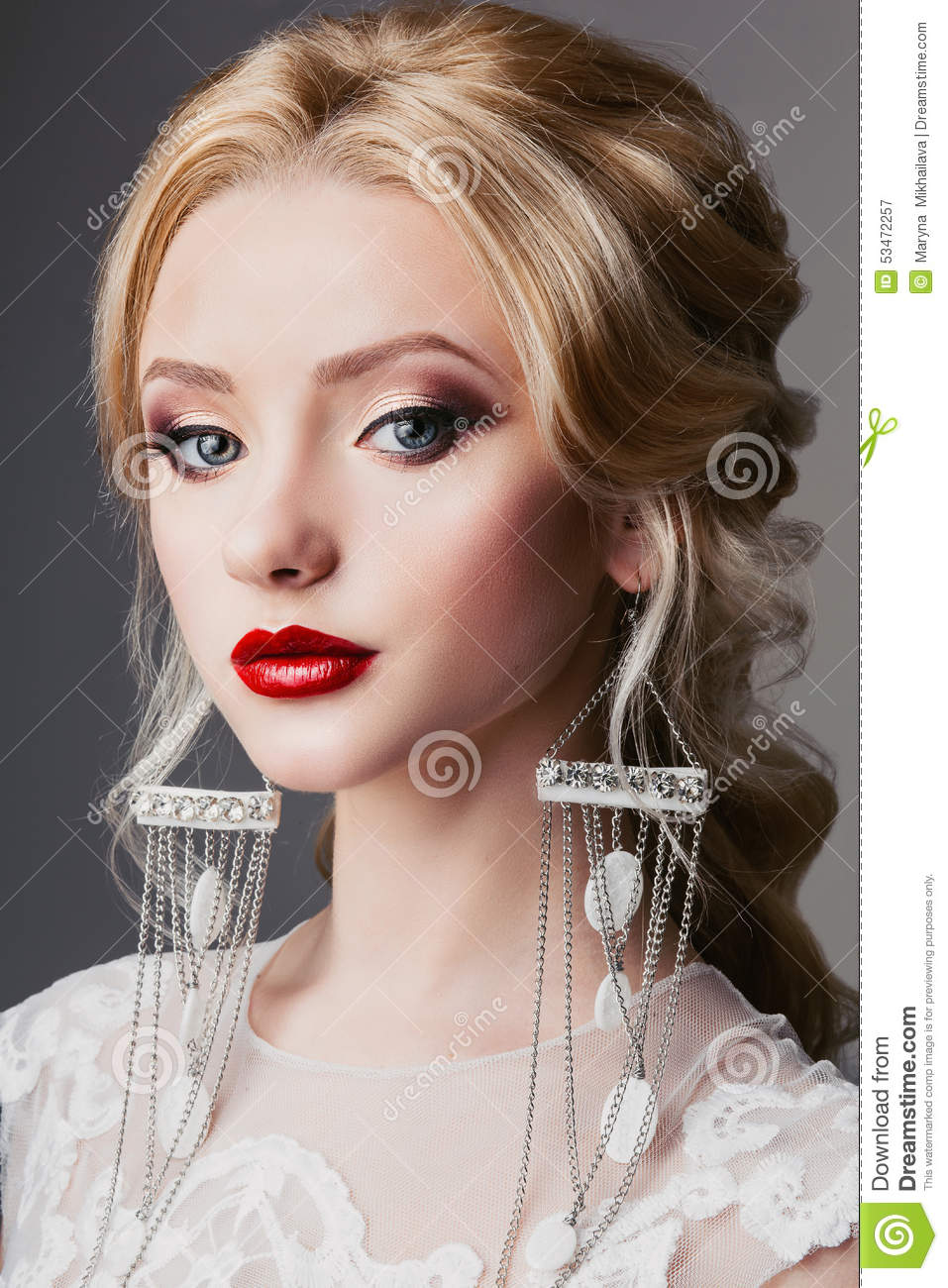 Portrait Of A Beautiful Young Blonde Woman With Long Curly