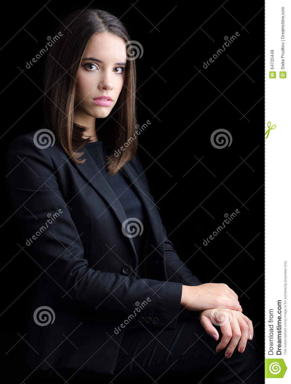 Portrait of beautiful young business woman isolated on black