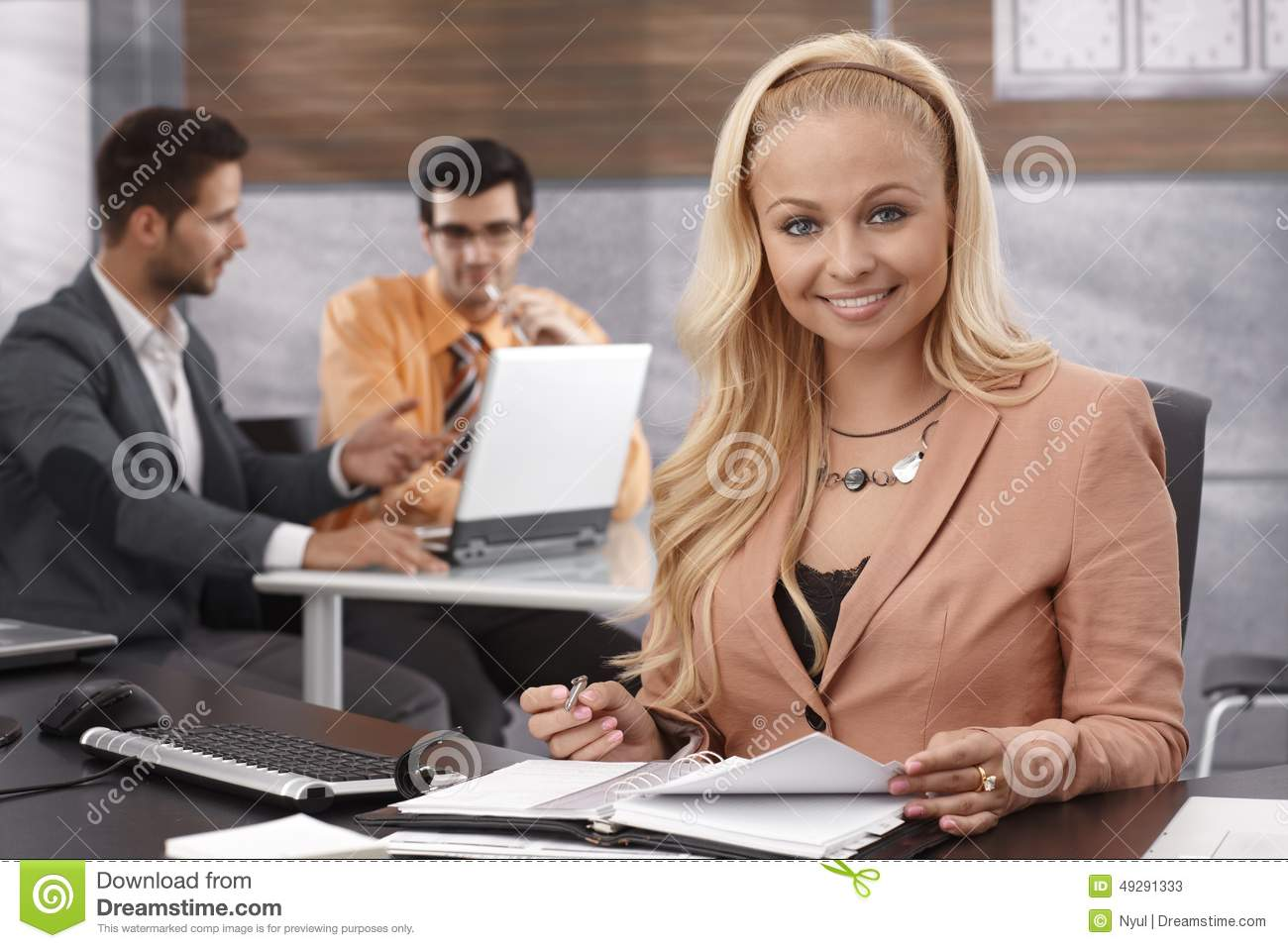 Beautiful Businesswoman Standing In Office, Holding ...