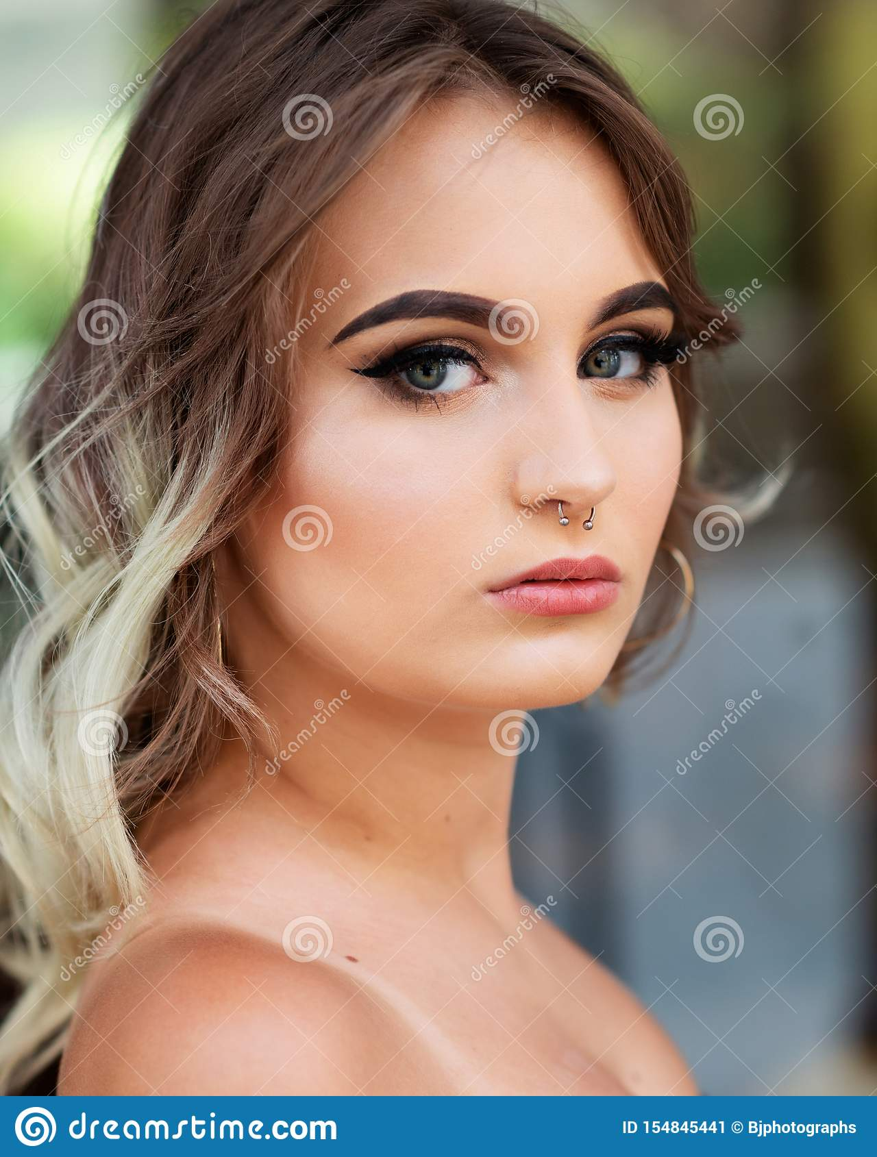 Portrait Of Beautiful Young Caucasian Girl With Barbell Septum