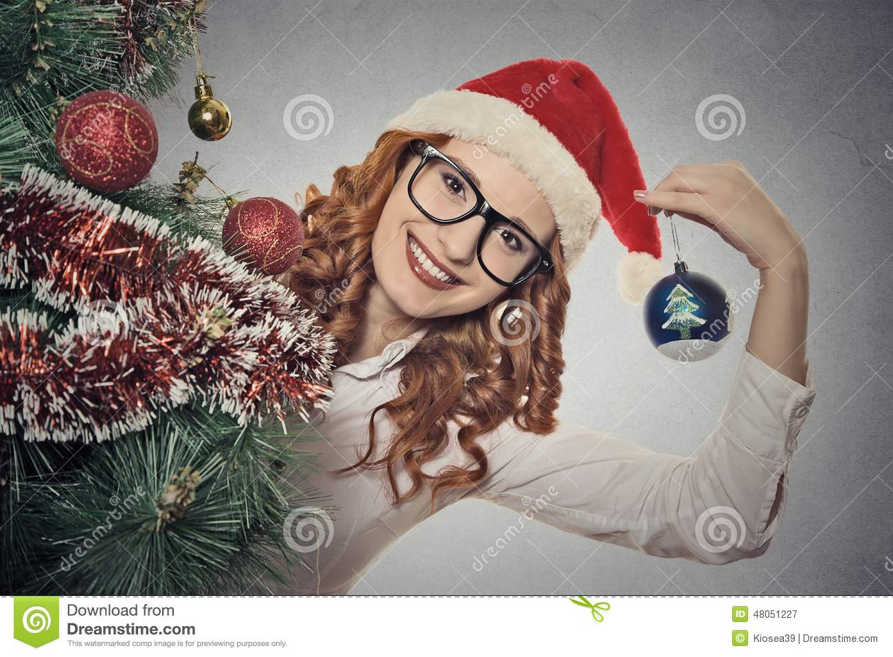 eab42b589b7a Portrait beautiful young christmas girl wearing santa claus clothes  isolated on grey wall background. Positive face expression, emotion,  feelings.
