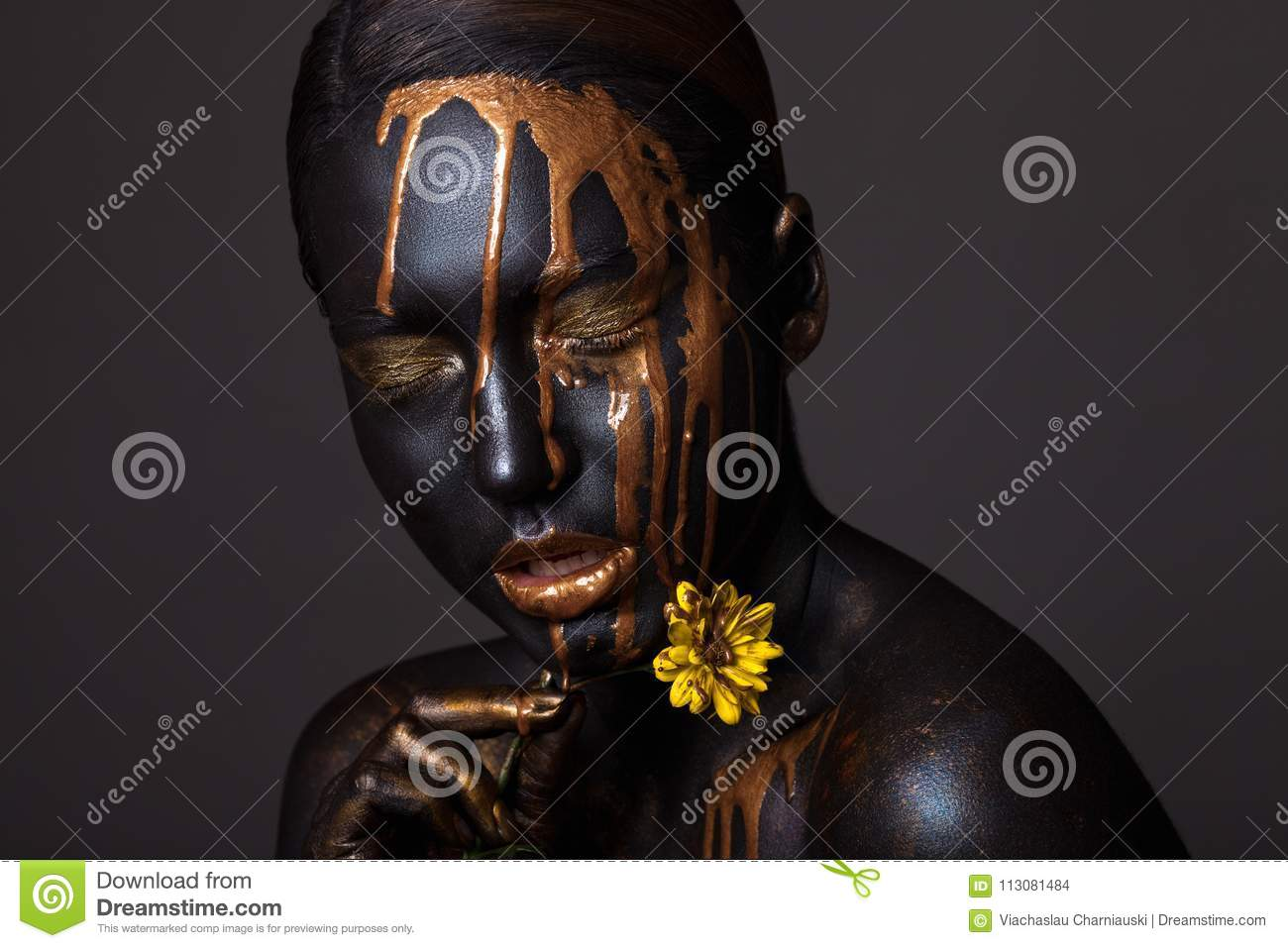 Portrait of a beautiful young girl and creative make-up.