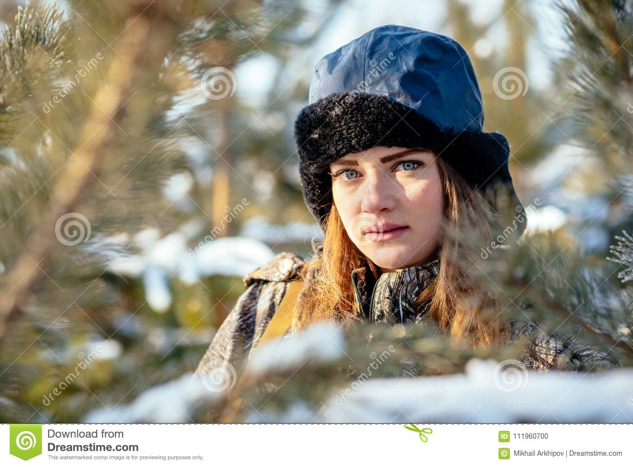 Portrait of a beautiful young girl while hunting in a winter pin
