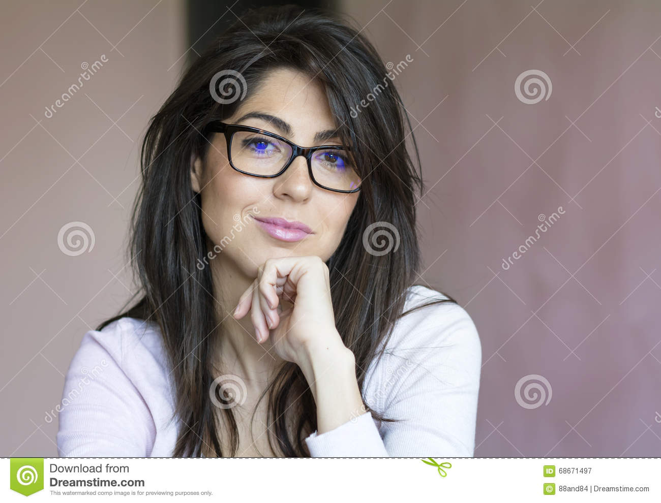 Portrait of beautiful young smiling woman with modern eyeglasses