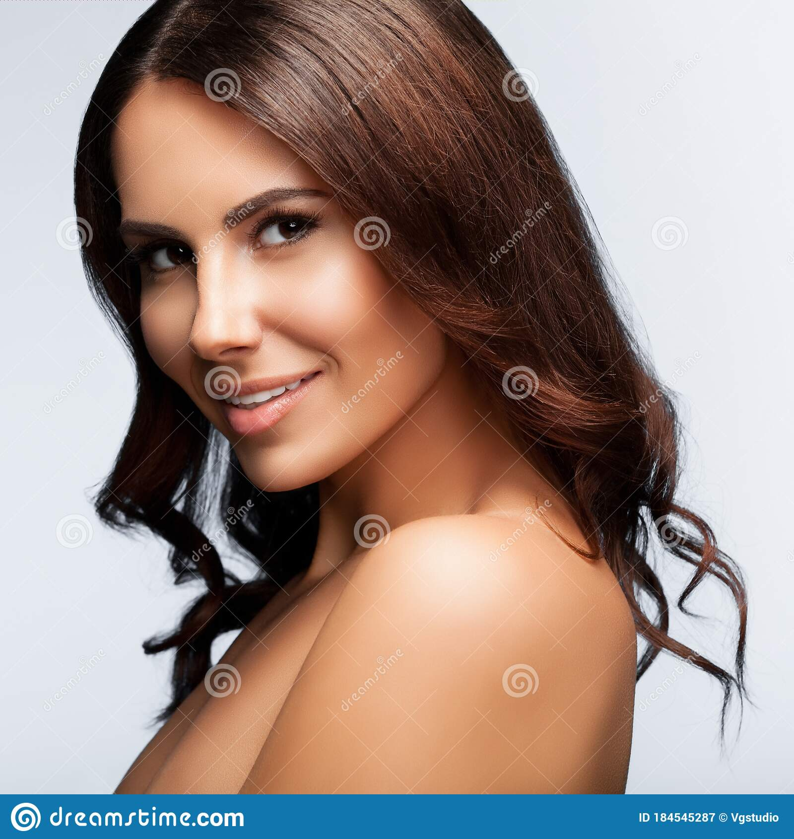 Portrait Of Beautiful Young Woman With Naked Shoulders, On