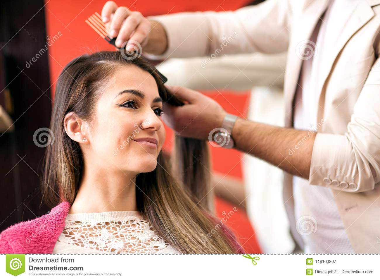 Portrait Of Beautiful Young Woman Getting Haircut Stock Image