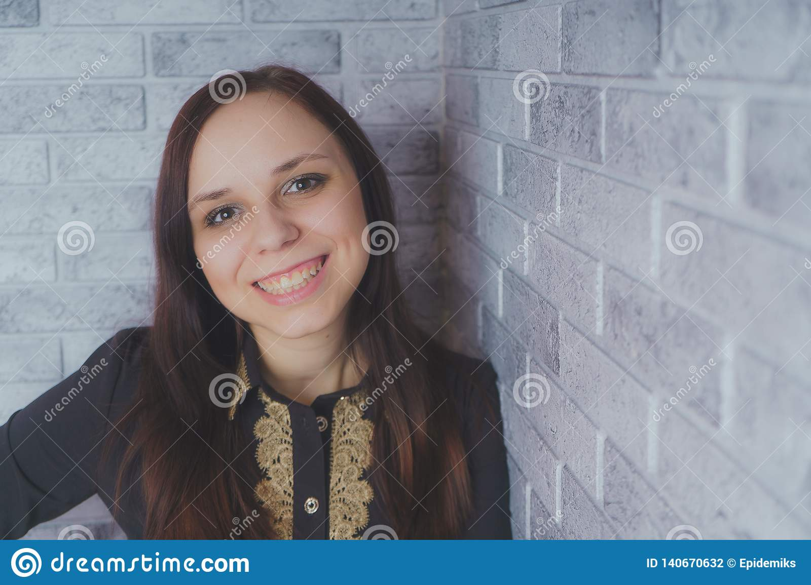 Portrait of beautiful young woman happiness standing on gray cement texture grunge wall brick background