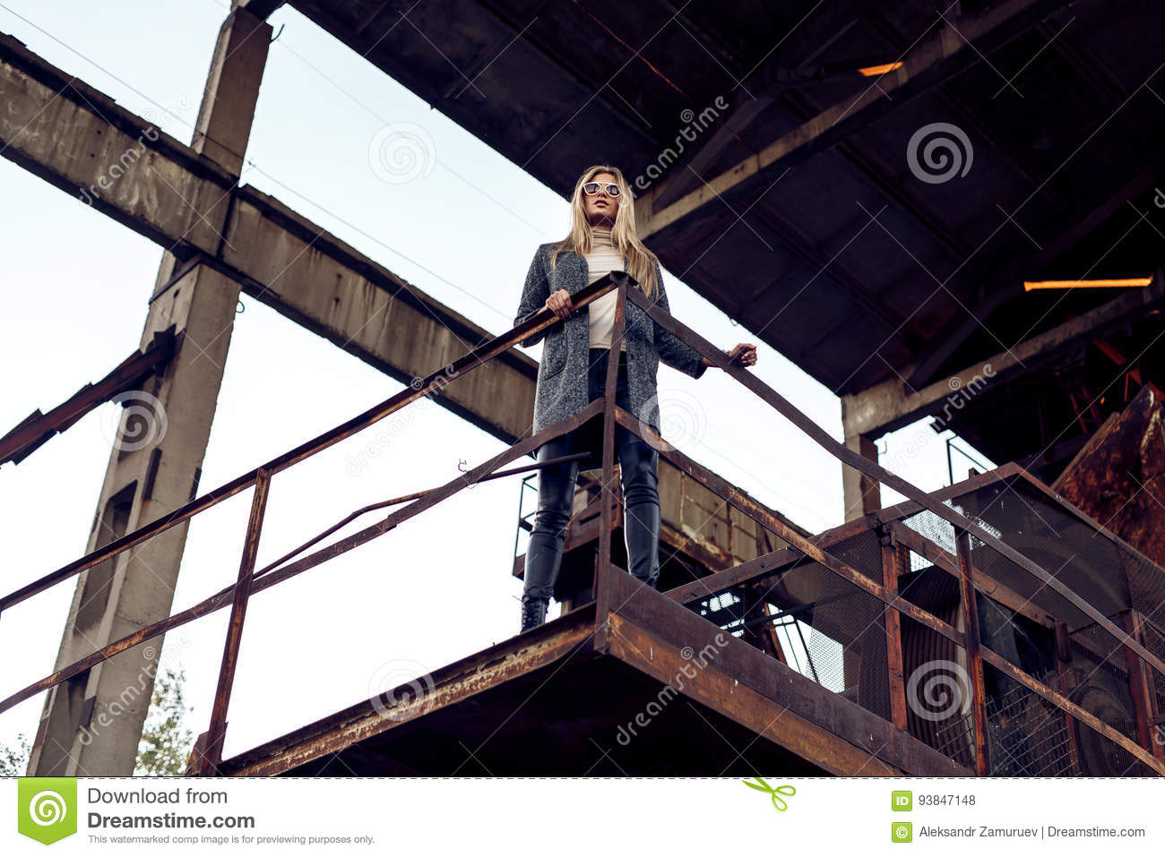 Portrait of a beautiful young woman in an industrial background