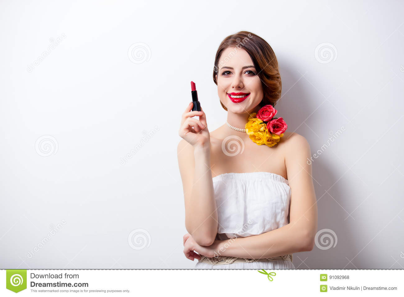 Portrait of beautiful young woman with lipstick on the wonderful