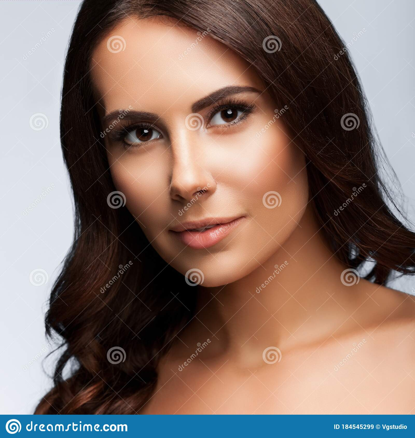 Young Woman With Naked Shoulders, On Grey Stock Image
