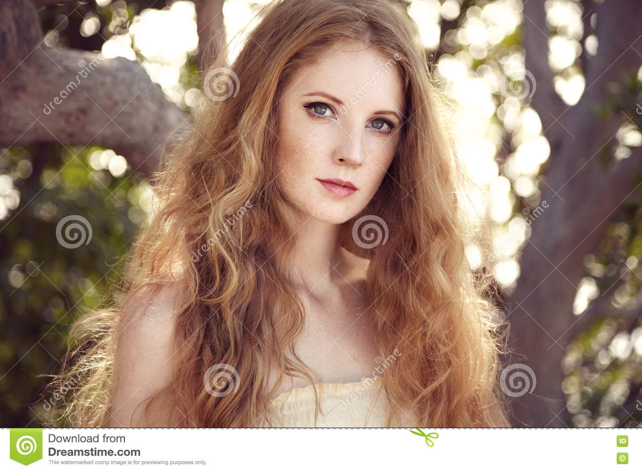 Portrait Of A Beautiful Young Woman In Summer Garden Stock Photo ...