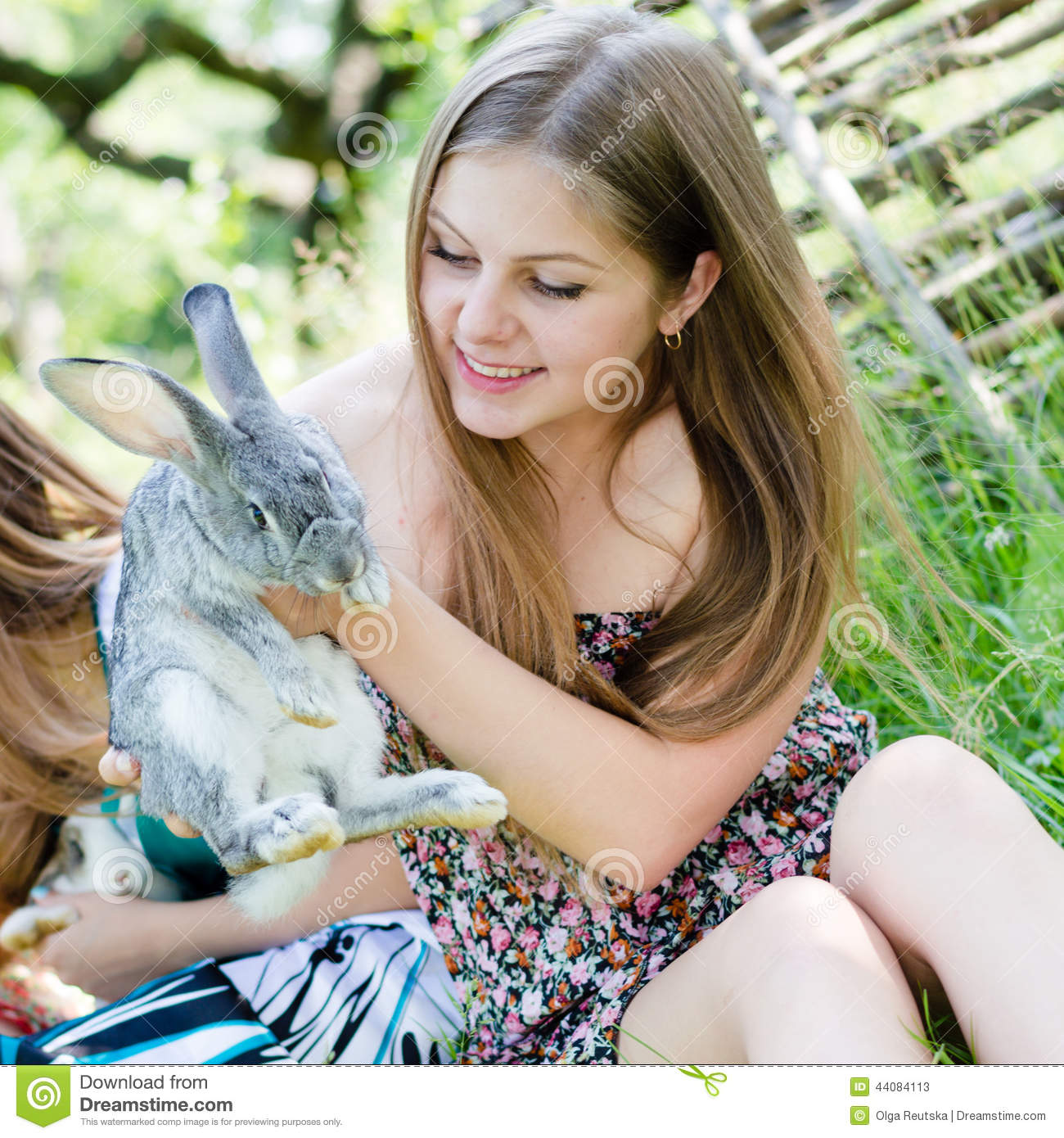portrait of beautiful young woman sweet smiling girl with a rabbit