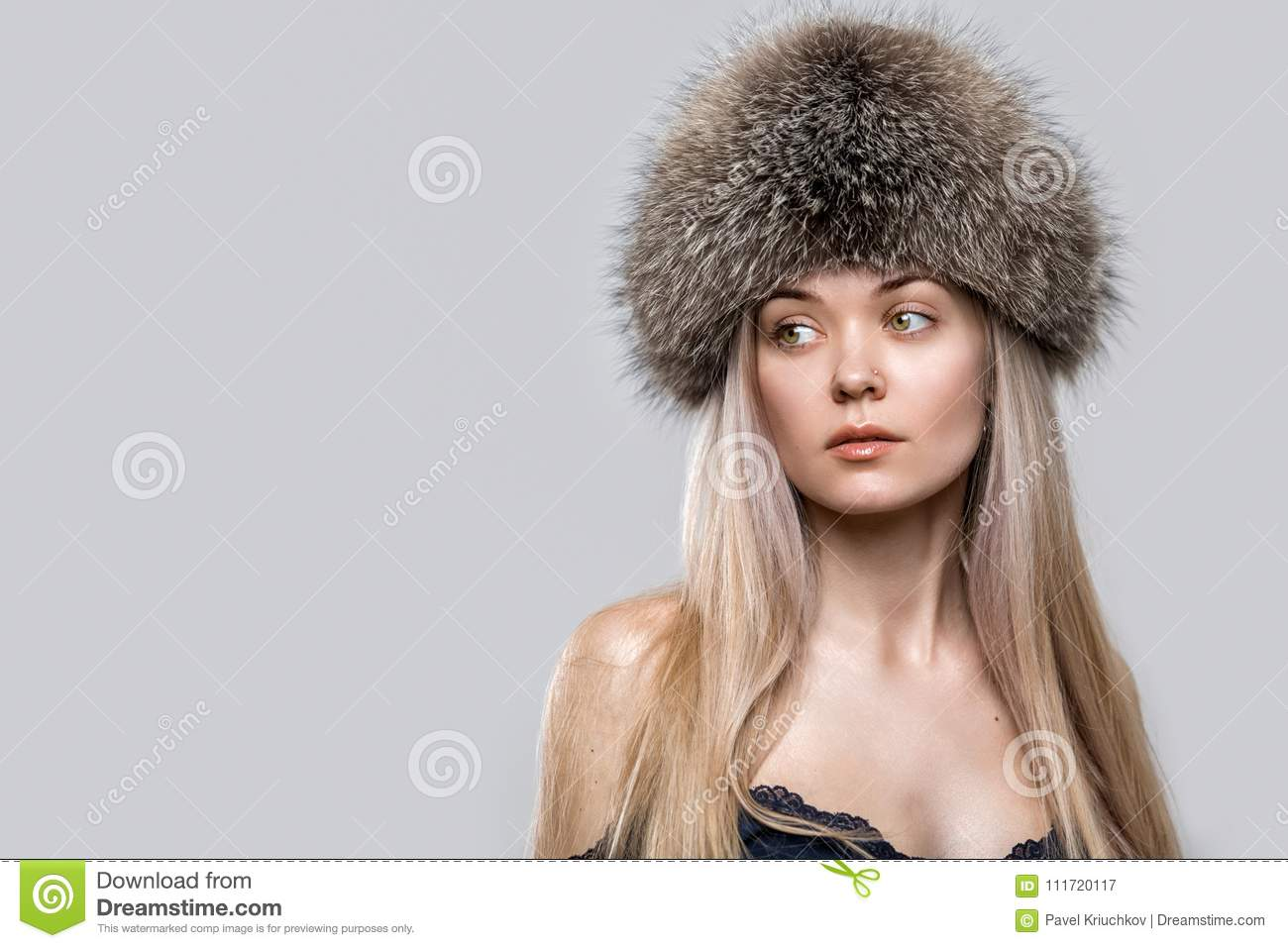 Portrait Of A Beautiful Young Woman In A Trendy Fur Hat