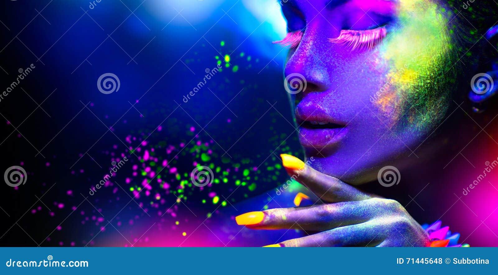 Portrait of beauty fashion woman in neon light