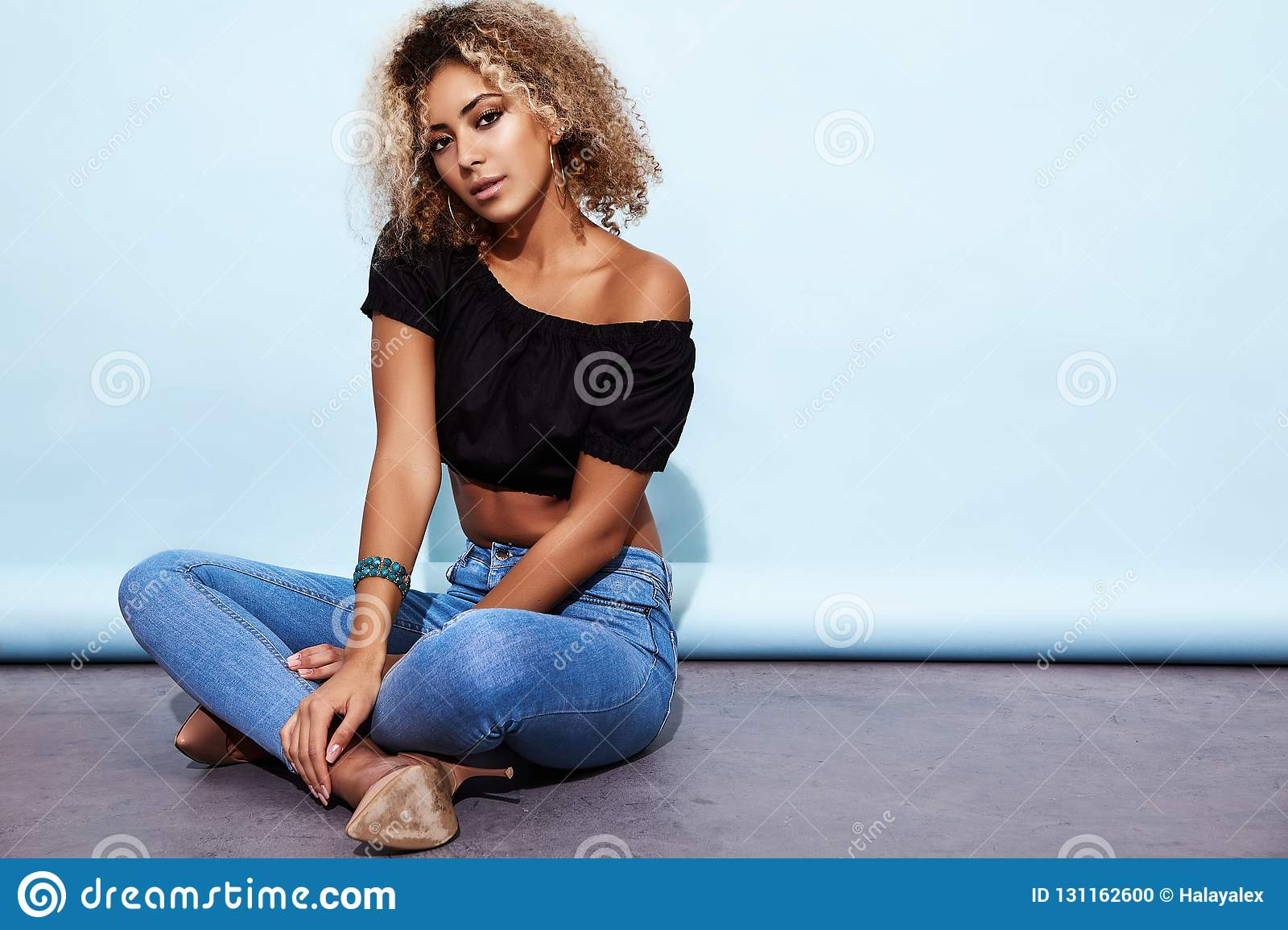 Woman With Blond African Hairstyle In Trendy Summer Clothes Stock