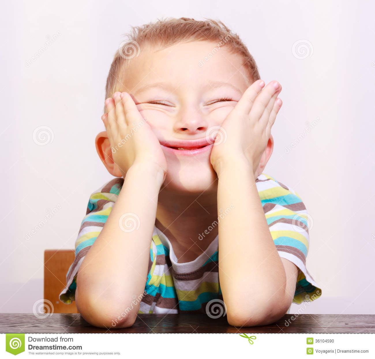 portrait of blond boy child kid making funny face at the table - Fun Kid Pictures