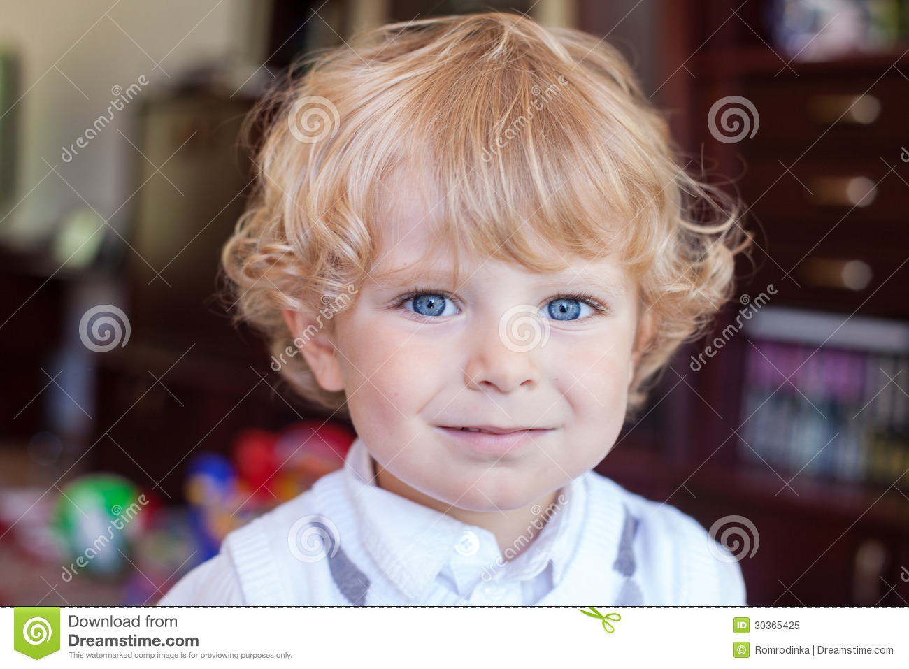 Portrait Of Blond Toddler Boy With Curly Hairs Stock Image