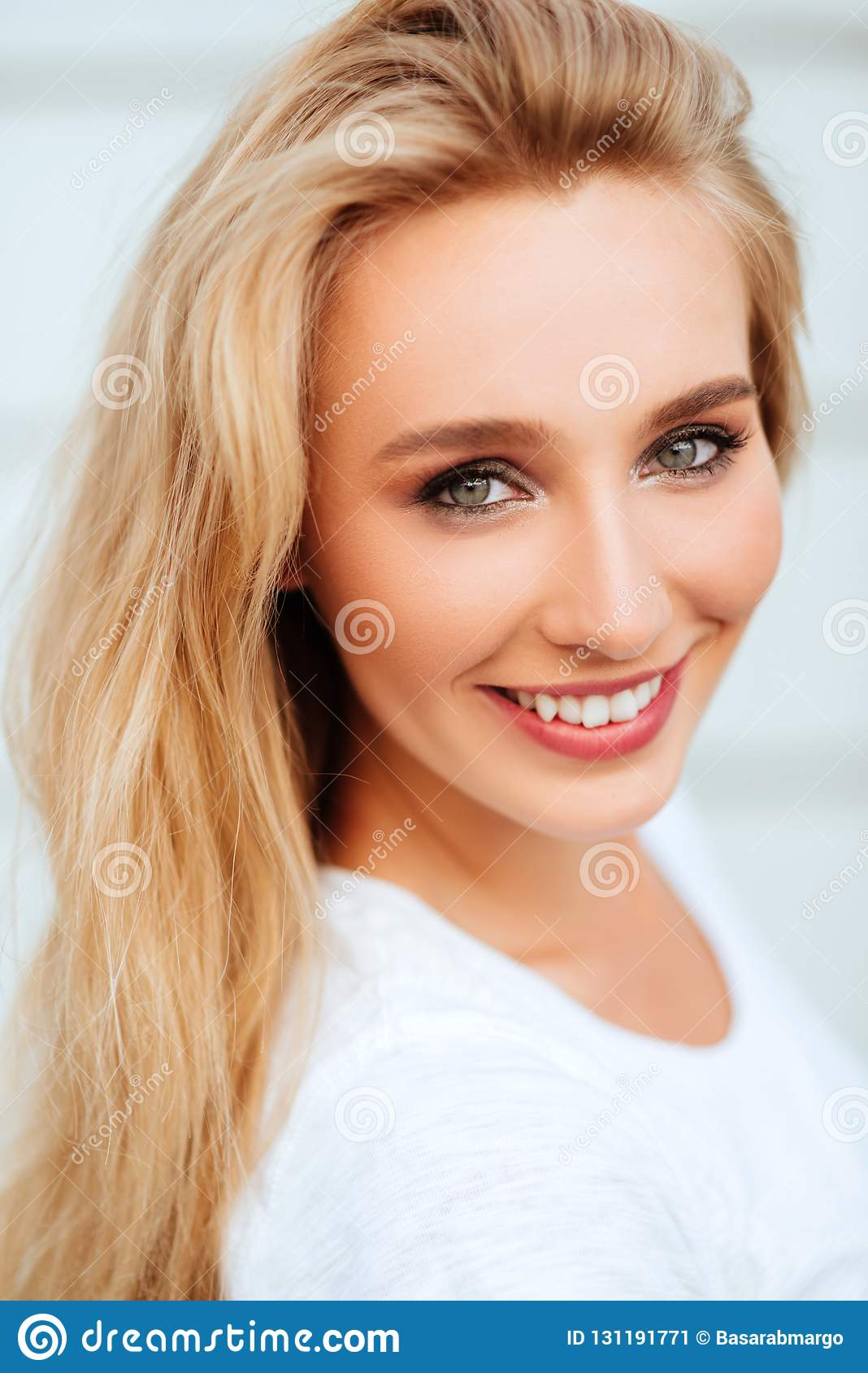 Portrait of blond young woman posing outdoors