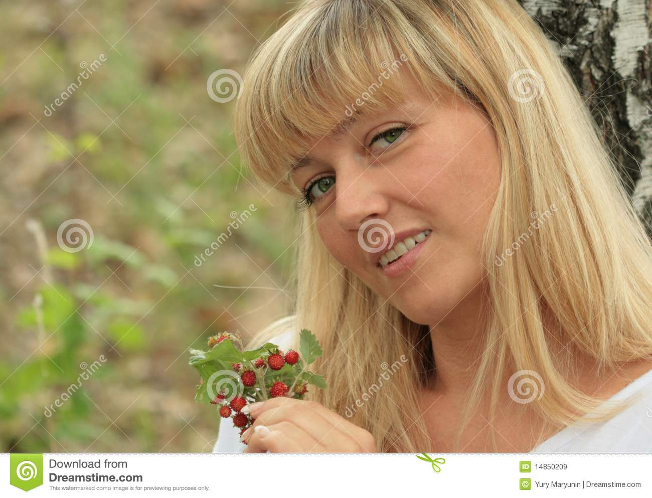 Portrait of the blonde with berries
