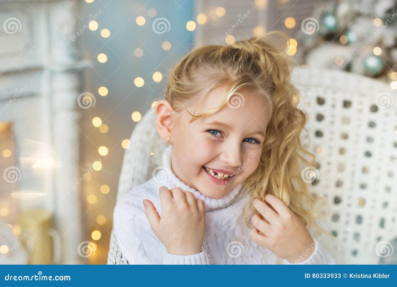 portrait of blonde pretty little girl very smiles in. Black Bedroom Furniture Sets. Home Design Ideas