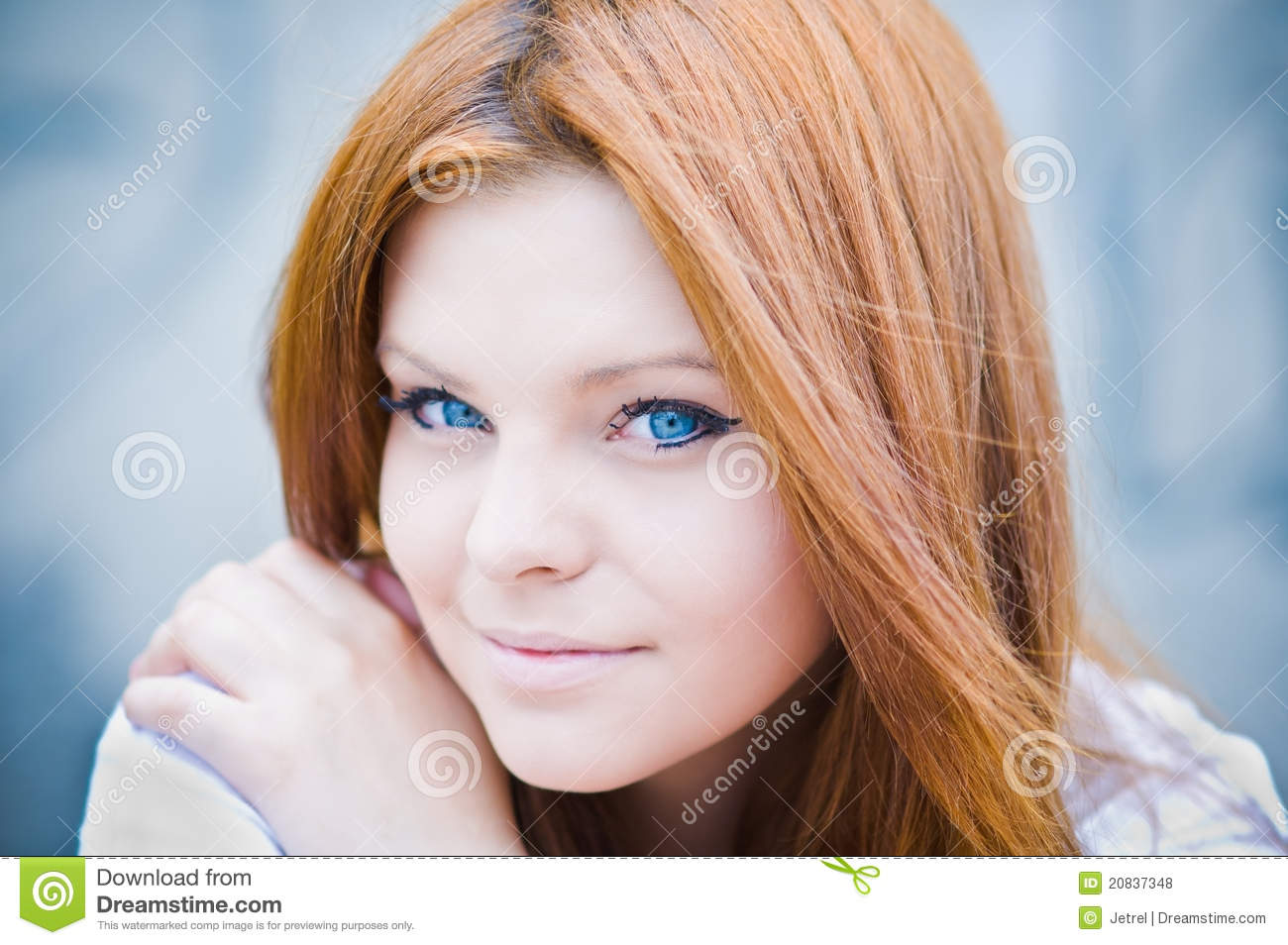 Portrait of blue-eyed beautiful girl in high key