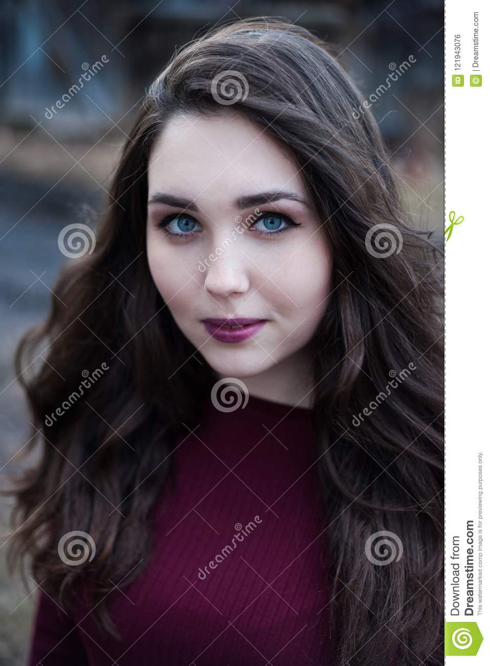 girl with black hair blue eyes portrait of a blue eyed girl with dark hair in cherry