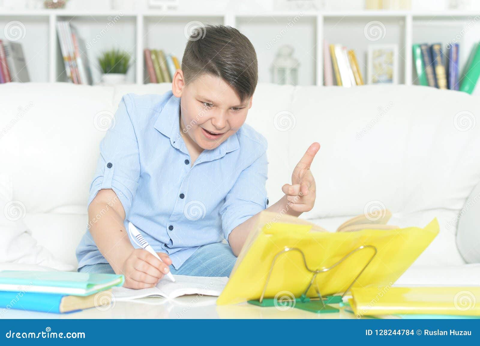 portrait of boy doing homework at home stock photo image of rh dreamstime com Doing Math Homework Boy Doing His Homework