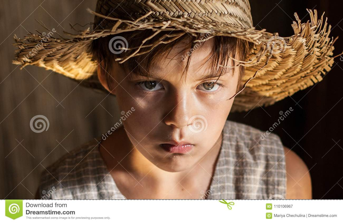 Portrait Of A Boy In A Straw Hat And Vest Stock Image - Image of ... ac48e8278f51