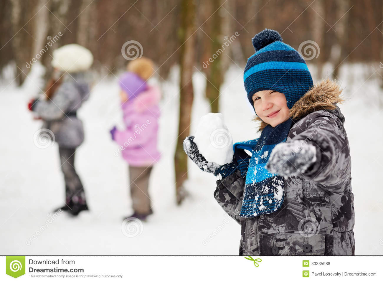 portrait of boy which aims with snowball royalty free