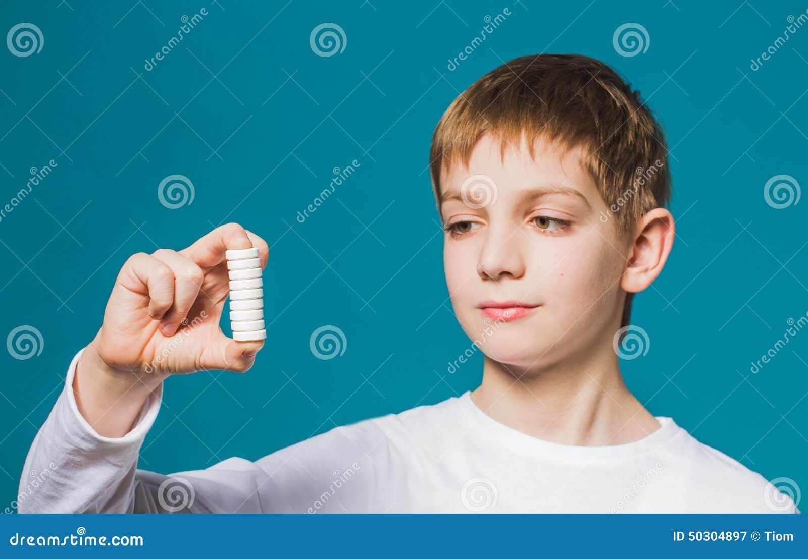 Little Boy Holding Pills Royalty-Free Stock Image ...
