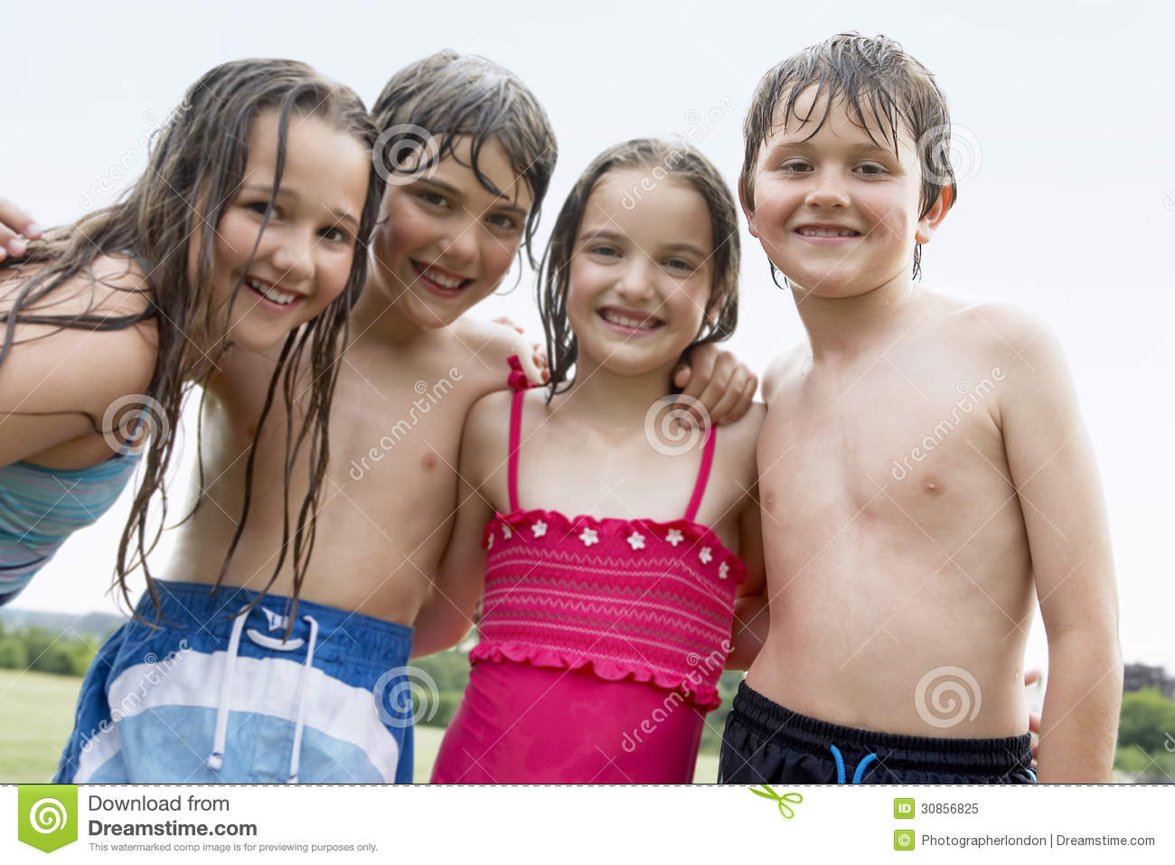Portrait Of Boys And Girls In Swimsuits Smiling Together ...