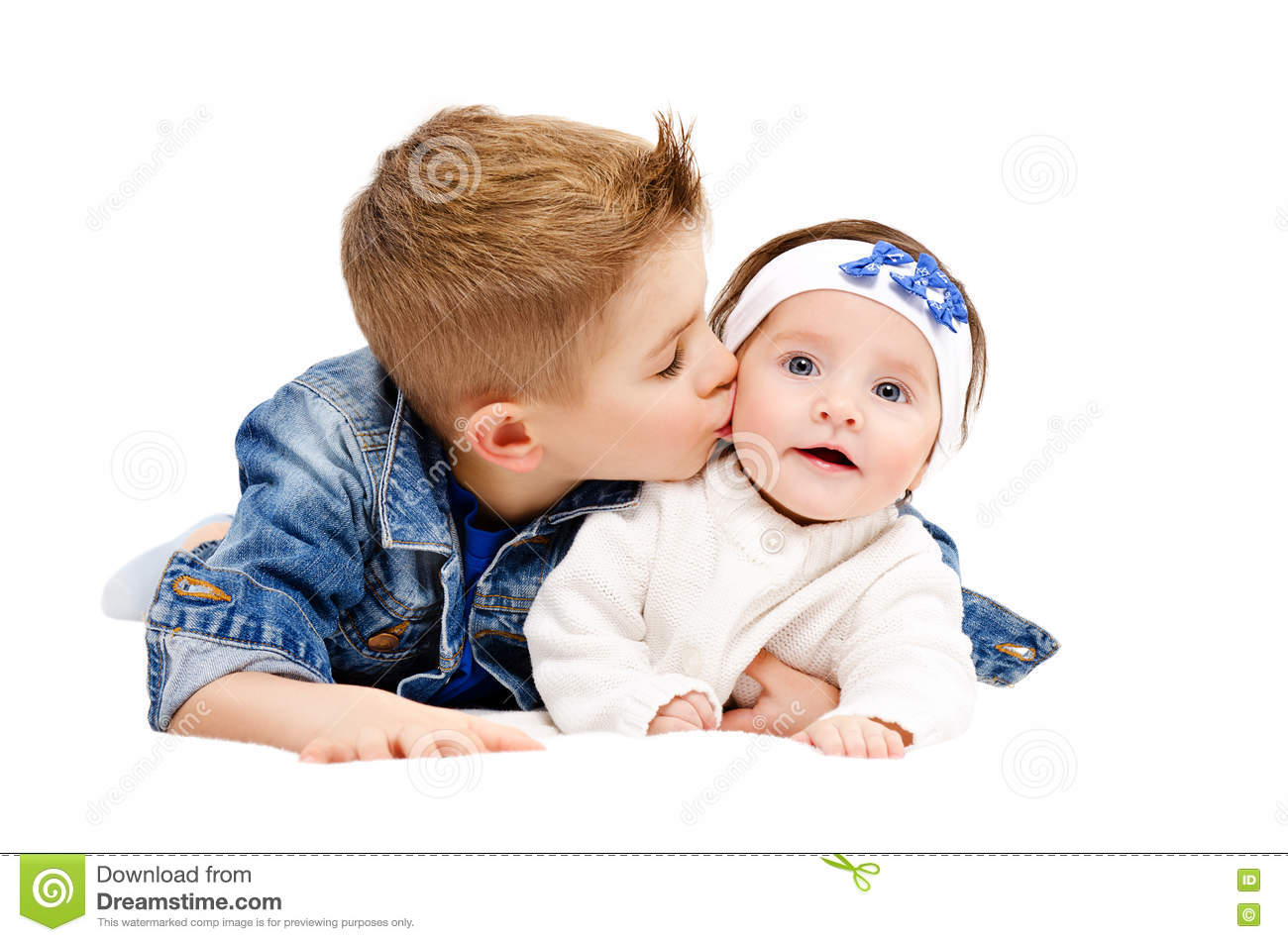 Portrait Of Brother Kissing His Little Cute Sister Stock Photo