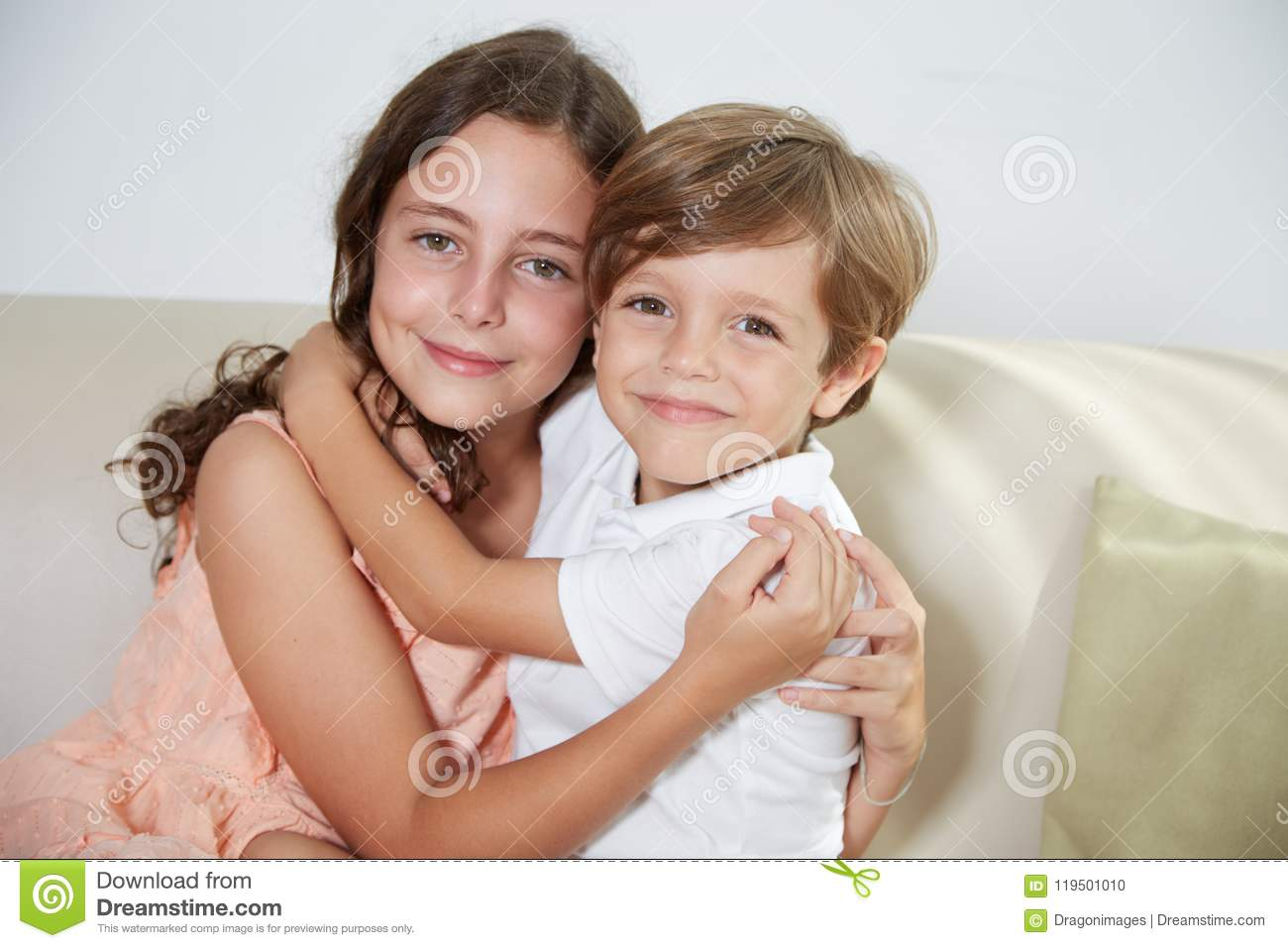 Japanese Brother And Sister Hugging Each Other Stock