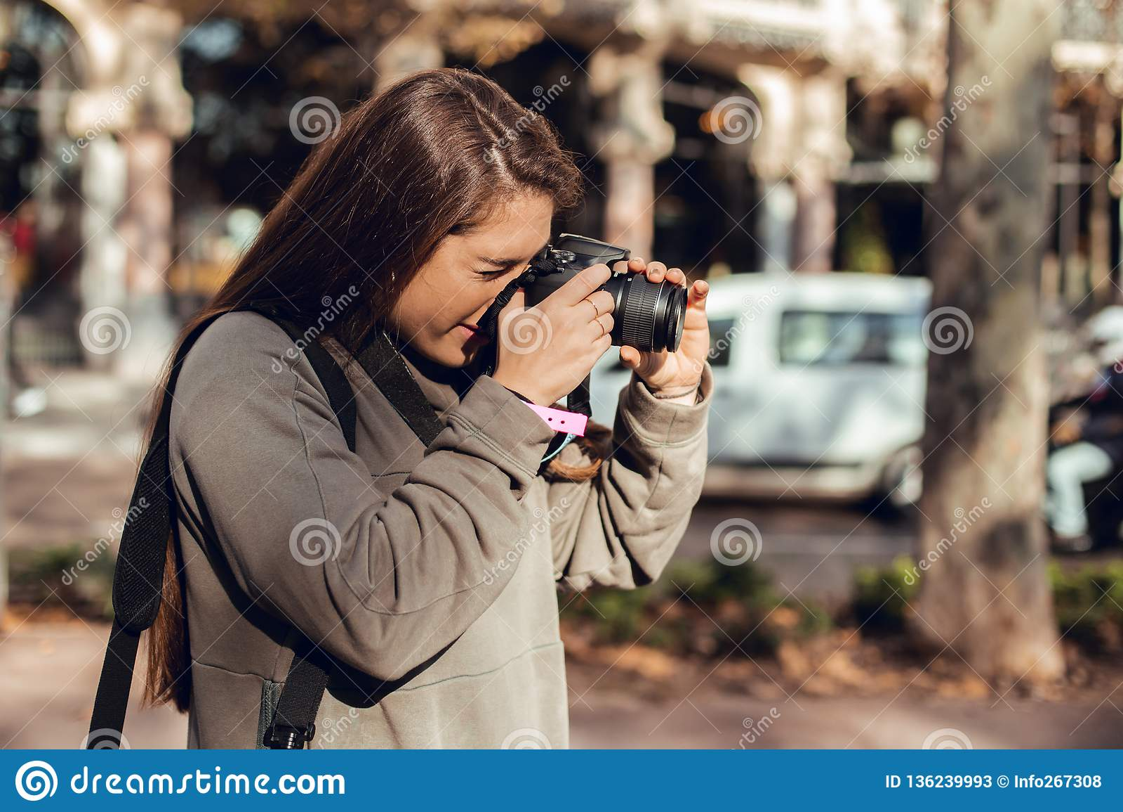Portrait of brunette girl taking pictures